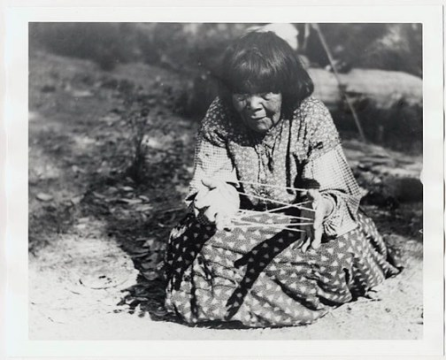 First Nations woman with cat's cradle
